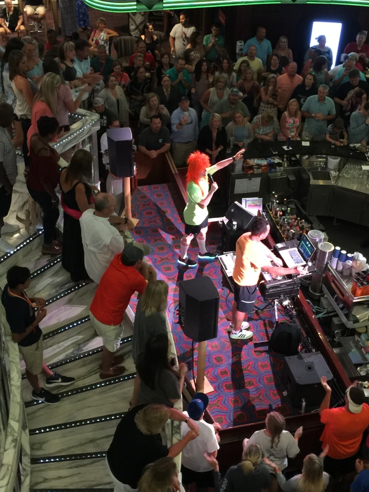 Carnival Fantasy-Cruise Director Hosting Sing-a-Long-Last Night Aboard in the Atrium