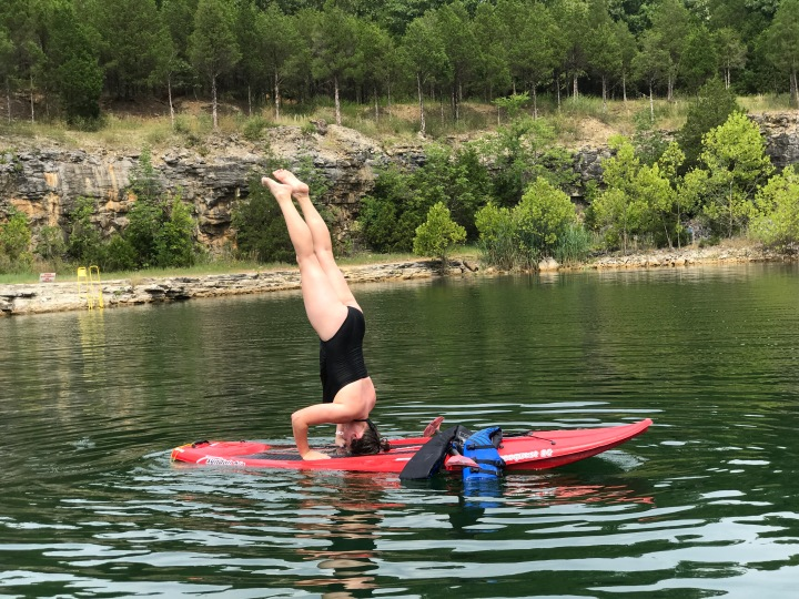 Faith Headstand on Paddle Board