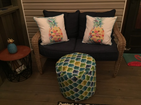 White Pillows with Multi-Colored Pineapple Pillows for a Pop of Color
